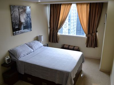 Photo for Quiet 1BR High Atop Bonifacio Global City The Fort Breathtaking View Cable+WiFi