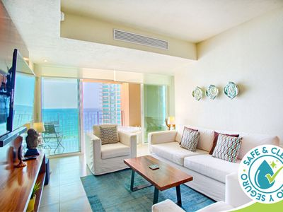 Photo for Bright and Breezy Ocean View Condo | Infinity Pools, Gym, Tennis Court