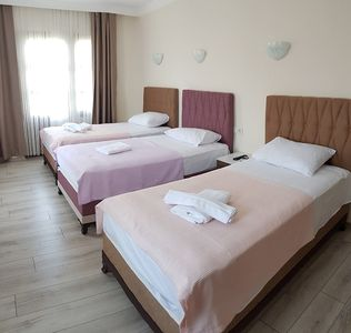 Photo for Sezgin Boutique Hotel TripleRoom A/C,TV,fridge,pool,garden,free wi-fi & car park