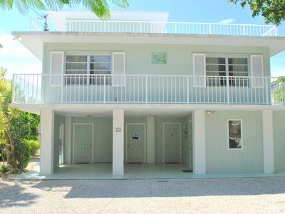 Photo for Delightful 4 Bedroom Canal Front Home with Ocean Views - 164 Plantation Shores Dr.