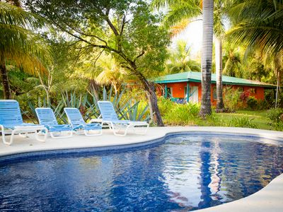 Photo for Surfer's Nest, Beachfront Cottage -Fully equipped - Pool -ac-WiFi -housekeeping