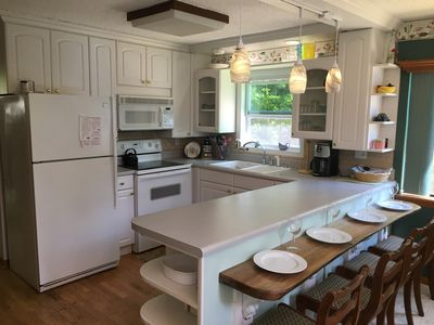 FULLY EQUIPPED KITCHEN ATTACHED TO DINING AREA NEXT TO GRILL DECK