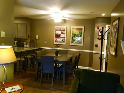 Dining area with expanding table.  Seats 8 comfortably & 3 more at breakfast bar