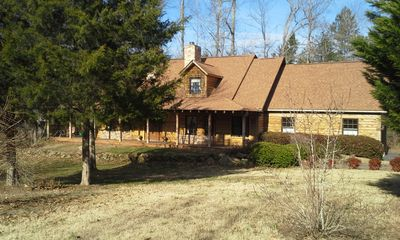 Photo for Cedar log home in a serene locale close to Winston Salem, Greensboro, High Point