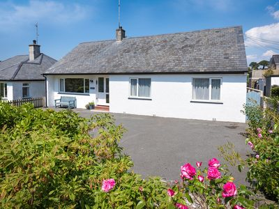 Photo for Tastefully decorated and furnished to give a light and airy feel, this delightful bungalow is just a
