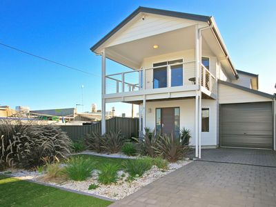 Photo for Sunset @ Snapper Point - Modern Coastal Beauty with Large Balcony and Sea Views
