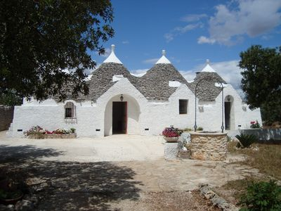 Photo for Trulli Arcobaleno in the countryside, garden of 7000 m, free wifi, near the sea