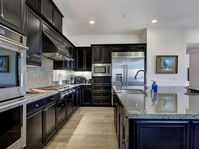 Photo for Golfer's Delight - Pristine, modern PGAWEST home w/luxury pool +clubhouse access