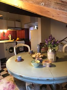 In the attic: cozy dining room under the rooftop