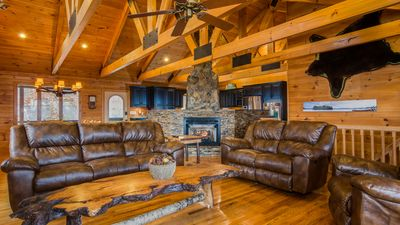 Upstairs family room w/ leather furniture, floor to ceiling gas log fireplace!
