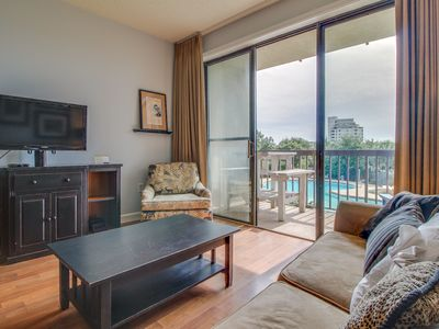 Contemporary bayfront condo with bay views, shared pool & dock access