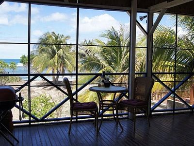 The front porch at the Beach Bungalow -- overlooking a magnificant palm studded