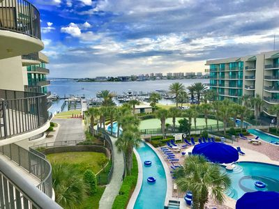 Photo for TAKE A LOOK AT OUR EXCEPTIONAL 4TH FLOOR VIEW OF LAZY RIVER, POOLS, & BAY
