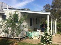A quaint little weatherboard cottage in a pretty spot by the King River