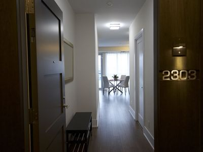 Photo for Luxury condo steps from CN Tower with underground parking ( $)