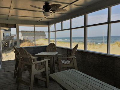 Covered oceanfront porch with ceiling fan, tall table with chairs & picnic table