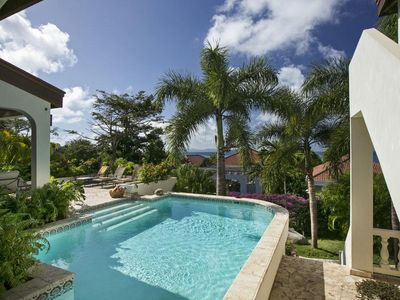 Photo for Steps from the Sea, Swimming Pool, Coral-Stone Decking, Poolside Wet Bar, Covered Verandah