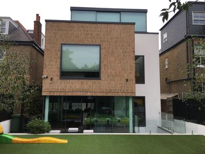 Photo for Wimbledon Modern Luxury Home Sleeps 8-10 with own parking