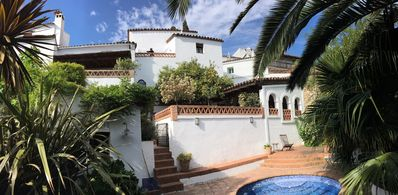Panorama view of house from the pool