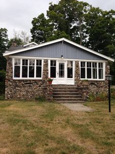 Photo for Cute As A Button Stone Cottage In The Village Of Suttons Bay