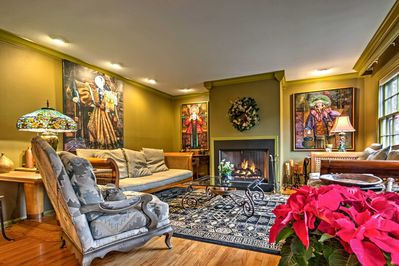 Cozy up to the fire in this warm living room featuring plush furnishings.