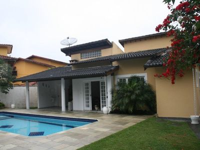 Photo for Story home in Cond. Costa del Sol - Bertioga, 300 meters from the beach, with outdoor pool