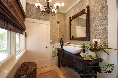 'Hibiscus' - This charming bathroom is on the first floor off of the kitchen & b
