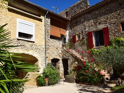 Photo for Charming cottage with terrace patio jacuzzi in restored cevenol farmhouse near Alès