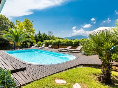 Photo for Contemporary Oasis with views, Pool & Sauna - Walk to Beach & Center