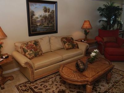Tommy Bahama Furnishings throughout Living Room