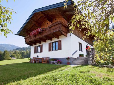 Photo for This neat holiday home is just above the charming village of Hüttau.