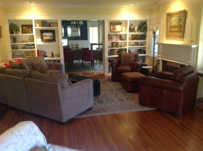 Extra Large Living room with fireplace, leather club chairs and more.