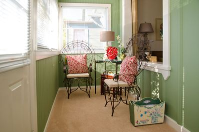 Sunroom with French wire chairs.