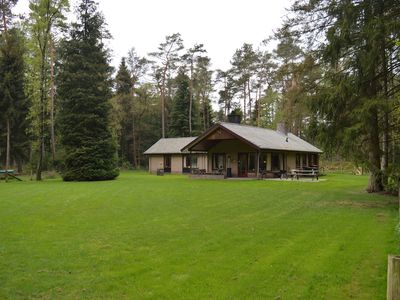 Photo for Private bungalow with tennis court for family in the middle of the Veluwe