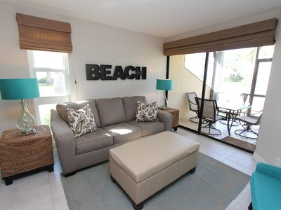 "Photo for Jun 8-15 Avail! Cayman Reef 47🌴 King bed 🌴65"" TV - Bright Airy FULLY stocked"
