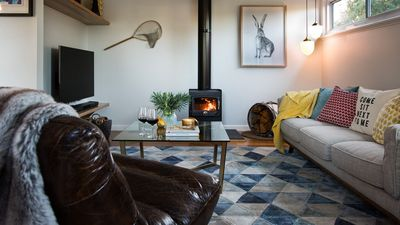 Cosy living room with fire and 50 inch TV