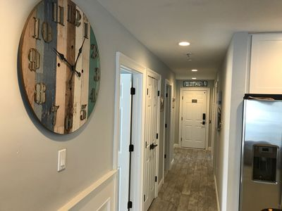 Spacious hallway leads to 4 bedrooms, 2 bathrooms and elevator