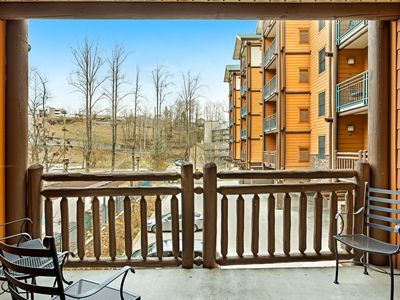 Photo for Polished downtown condo w/ fireplace & shared pool/hot tub/fitness room!