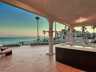Photo for NEW LISTING Luxurious Beachfront house on water, Private Jacuzzi, Grill, Firepit