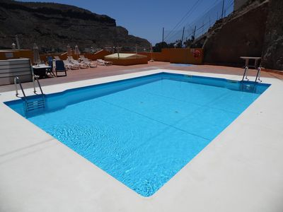 Photo for Puerto Mogan - Spacious, 3 bedroom, well equipped, safe apartment. Heated Pool