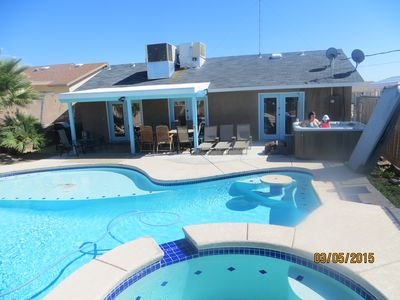 Beautiful backyard with huge pool, patio set, grill, and NEW 8 person hot tub!!