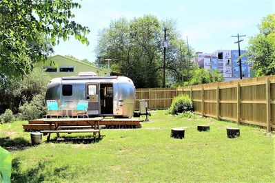 Great deck, picnic table to enjoy meals, and even enough room to pitch a tent!