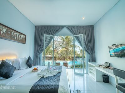 Photo for 2 Luxury deluxe rooms with 4 breakfast in Ubud area