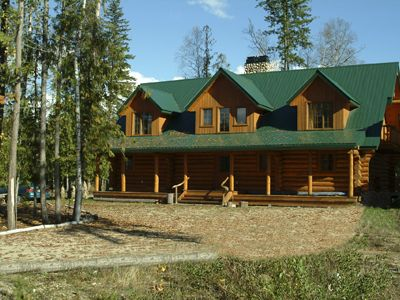 Photo for Luxurious 7 Bedroom Log Home With Hot Tub On The Golf Course