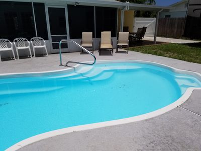 Photo for Beautiful PRIVATE pool home, 3 queen beds, kitchen close to everything
