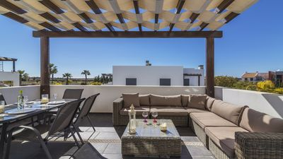 Photo for Beautiful 3 bedroom duplex apartment  with views across the golf towards the sea