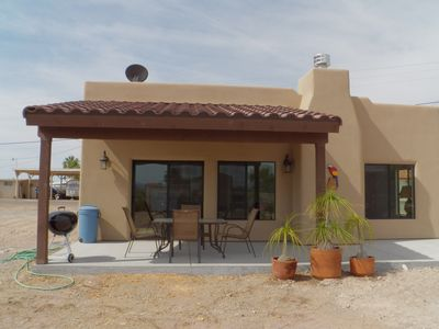 The back porch with desert views & outdoor dining table.
