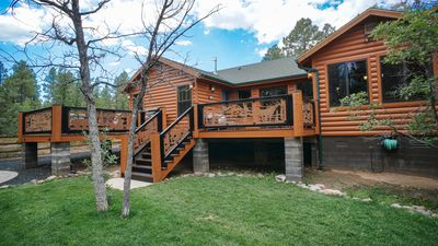 Photo for STUNNING CUSTOM BUILT CABIN RETREAT ON LARGE FENCED WOODED LOT WITH THEATER ROOM