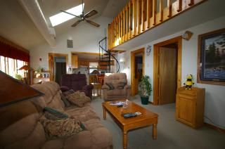 View of lower level. Notice circular staircase to 2nd level bedrooms.
