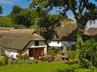 Photo for Unique idyllic holiday home under thatch on the Baltic Sea at Cape Arkona